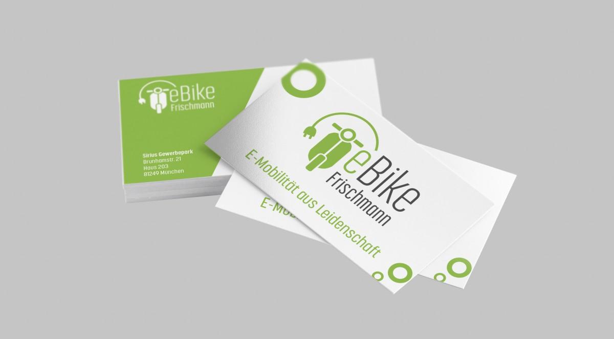 Visitenkarten von eBike Frischmann mit zwei abgehobenen Karten